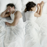 Unhappy couple not facing each other in bed