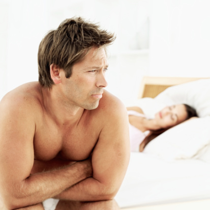Unhappy Man in bed
