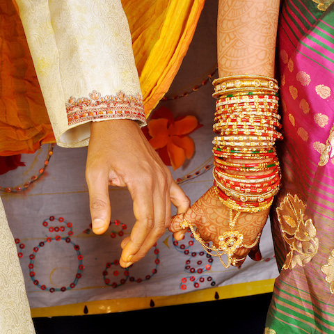 hands of a newly wed Indian couple