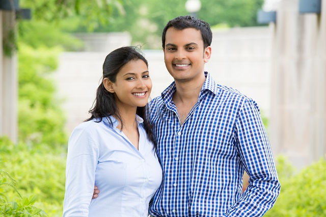 A happy Indian couple standing together