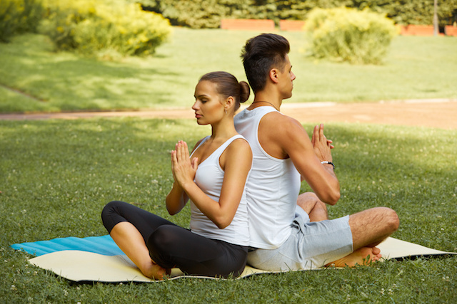 young couple doing Yoga Exercise